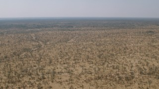 CAP_026_035 - HD stock footage aerial video of flying over a wide expanse of savanna, Zimbabwe