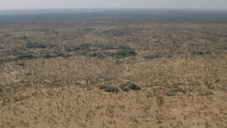 CAP_026_036 - HD stock footage aerial video of a wide expanse of savanna, Zimbabwe
