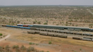 CAP_026_072 - HD stock footage aerial video of flying by trains at a train station, Zimbabwe