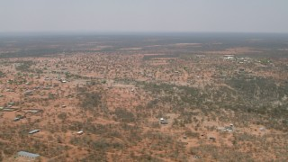 CAP_026_081 - HD stock footage aerial video of flying by a village surrounded by savanna, Botswana