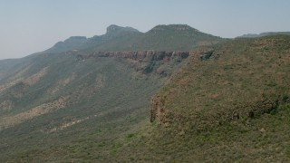 CAP_026_096 - HD stock footage aerial video of passing by mountains in Zimbabwe