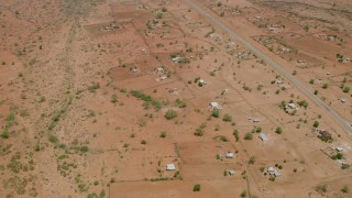 CAP_026_104 - HD stock footage aerial video of orbiting homes in a village near the road in Zimbabwe