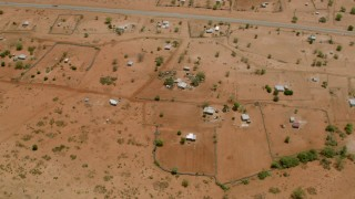 CAP_026_105 - HD stock footage aerial video of circling homes in a village near the road in Zimbabwe