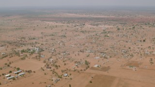 CAP_026_109 - HD stock footage aerial video of flying by an African village in Zimbabwe