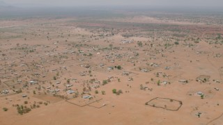 CAP_026_110 - HD stock footage aerial video of passing by an African village in Zimbabwe