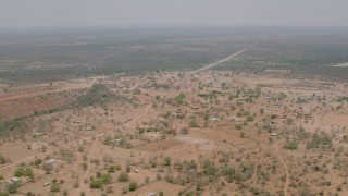 CAP_026_114 - HD stock footage aerial video of flying over an African village in Zimbabwe