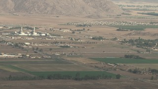 CBAX01_006 - HD stock footage aerial video of tracking Cessna 340 in flight over farmland, hazy, Perris, California