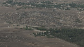 CBAX01_011 - HD stock footage aerial video of flying over rural countryside, revealing Cessna 340 flying, Perris, California