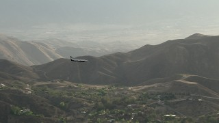 CBAX01_022 - HD stock footage aerial video of tracking Cessna 340 over hazy hills, rural countryside, Perris, California