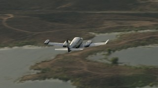 CBAX01_027 - HD stock footage aerial video of tracking Cessna 340 over Lake Mathews on a hazy day, Perris, California