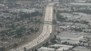 CBAX01_032 - HD stock footage aerial video of flying by traffic on Highway 91, hazy day, Corona, California