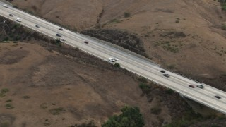 CBAX01_046 - HD stock footage aerial video of tracking light traffic on Highway 71 through hills, Chino Hills, California