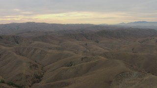 CBAX01_048 - HD stock footage aerial video of flying over mountain range with partly cloudy skies, Chino Hills, California