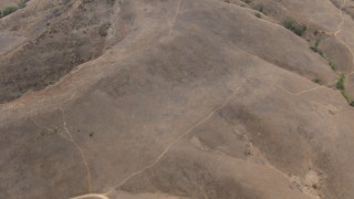 CBAX01_051 - HD stock footage aerial video of a bird's eye view of a mountain range, Chino Hills, California