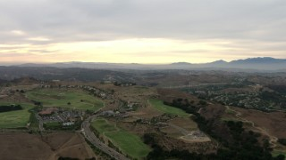 CBAX01_055 - HD stock footage aerial video of flying over golf course, upscale neighborhood, cloudy, Chino Hills, California