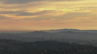 CBAX01_056 - HD stock footage aerial video of clouds over Los Angeles Basin, seen from Chino Hills, California, sunset