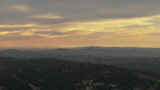 CBAX01_057 - HD stock footage aerial video of clouds over Los Angeles Basin, seen from Chino Hills, California, sunset