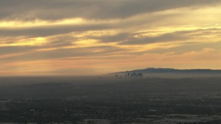 CBAX01_076 - HD stock footage aerial video of clouds and smoggy skyline, Downtown Los Angeles, California, sunset