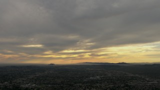 CBAX01_091 - HD stock footage aerial video of downtown, Los Angeles Basin, clouds, Central Los Angeles, California, sunset