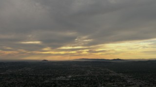 CBAX01_092 - HD stock footage aerial video of downtown, Los Angeles Basin, Pasadena, Central Los Angeles, California, sunset