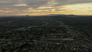 CBAX01_093 - HD stock footage aerial video of downtown, Los Angeles Basin, Pasadena, Central Los Angeles, California, sunset