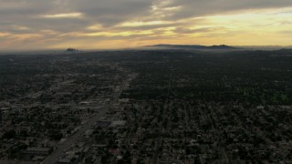 CBAX01_094 - HD stock footage aerial video of downtown, Los Angeles Basin, Pasadena, Central Los Angeles, California, sunset