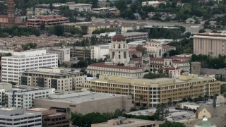 CBAX01_099 - HD stock footage aerial video of flying by Pasadena City Hall dome in Pasadena, California