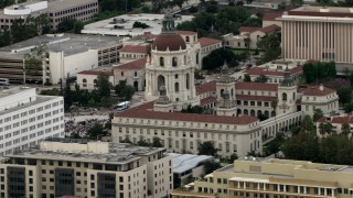CBAX01_101 - HD stock footage aerial video of passing Pasadena City Hall, with crowd in front of building, Pasadena, California