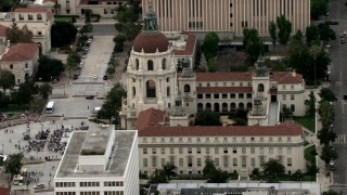 CBAX01_102 - HD stock footage aerial video orbit Pasadena City Hall, reveal crowd in front of building, Pasadena, California