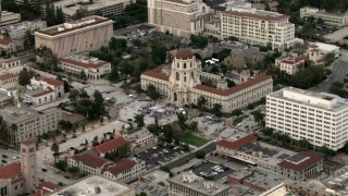 CBAX01_103 - HD stock footage aerial video of orbiting crowd in front of City Hall, Pasadena, California