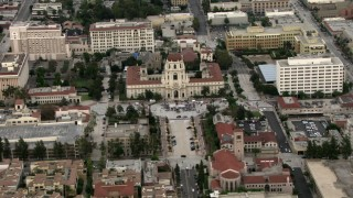 CBAX01_104 - HD stock footage aerial video of a view of a crowd gathered in front of Pasadena City Hall, Pasadena, California