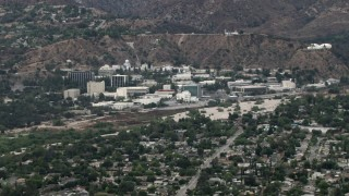CBAX01_106 - HD stock footage aerial video of approaching the Jet Propulsion Lab, Pasadena, California
