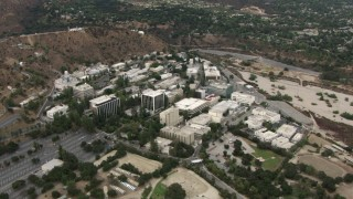 CBAX01_110 - HD stock footage aerial video of orbiting the Jet Propulsion Lab, Pasadena, California