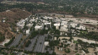 CBAX01_111 - HD stock footage aerial video of flying away from Jet Propulsion Laboratory, Pasadena, California