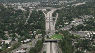 CBAX01_112 - HD stock footage aerial video of Interstate 210, Foothill Boulevard overpass, Highway 2 interchange, La Cañada Flintridge, California