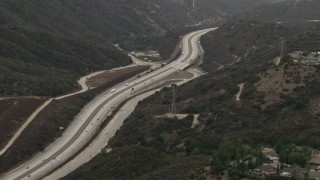 CBAX01_120 - HD stock footage aerial video of Interstate 210, light traffic, Tujunga, California