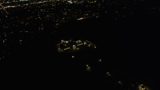 DCA01_004 - 5K stock footage aerial video flying by the Griffith Observatory at night, Los Angeles, California