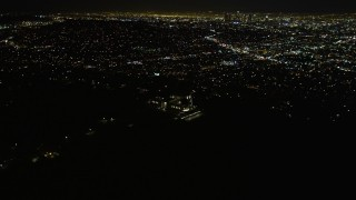 DCA01_005 - 5K stock footage aerial video flying by the Griffith Observatory at night, Los Angeles, California