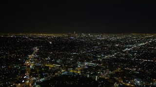 DCA01_006 - 5K stock footage aerial video approaching downtown Los Angeles skyline at night, California