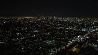 DCA01_007 - 5K stock footage aerial video tilt up revealing downtown Los Angeles skyline at night, California