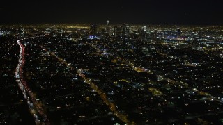 DCA01_009 - 5K stock footage aerial video tilt up revealing downtown Los Angeles skyline at night, California