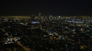 DCA01_010 - 5K stock footage aerial video flying by downtown Los Angeles skyline at night, California