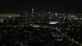DCA01_011 - 5K stock footage aerial video pan right revealing downtown Los Angeles skyline at night, California