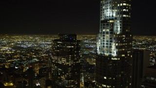 DCA01_014 - 5K stock footage aerial video flying by US Bank Tower at night, Los Angeles, California