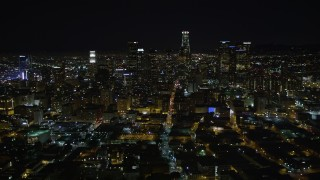 DCA01_015 - 5K stock footage aerial video flying away from Downtown Los Angeles skyline at night, California