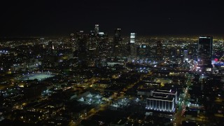 DCA01_021 - 5K stock footage aerial video orbiting Downtown Los Angeles skyline at night, California