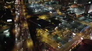 DCA01_023 - 5K stock footage aerial video following Los Angeles Highway 110 at night, California