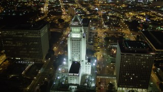 DCA01_026 - 5K stock footage aerial video approaching Los Angeles City Hall at night, California