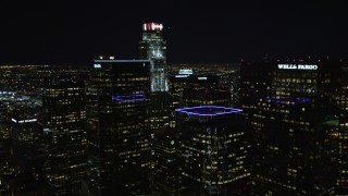 DCA01_031 - 5K stock footage aerial video flying through Downtown Los Angeles skyscrapers at night, California