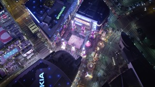 DCA01_036 - 5K stock footage aerial video orbiting bird's eye view of the Christmas fair at Nokia Theater at night, Los Angeles, California